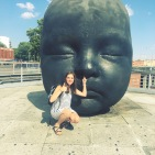 weird baby head statue outside the madrid train station